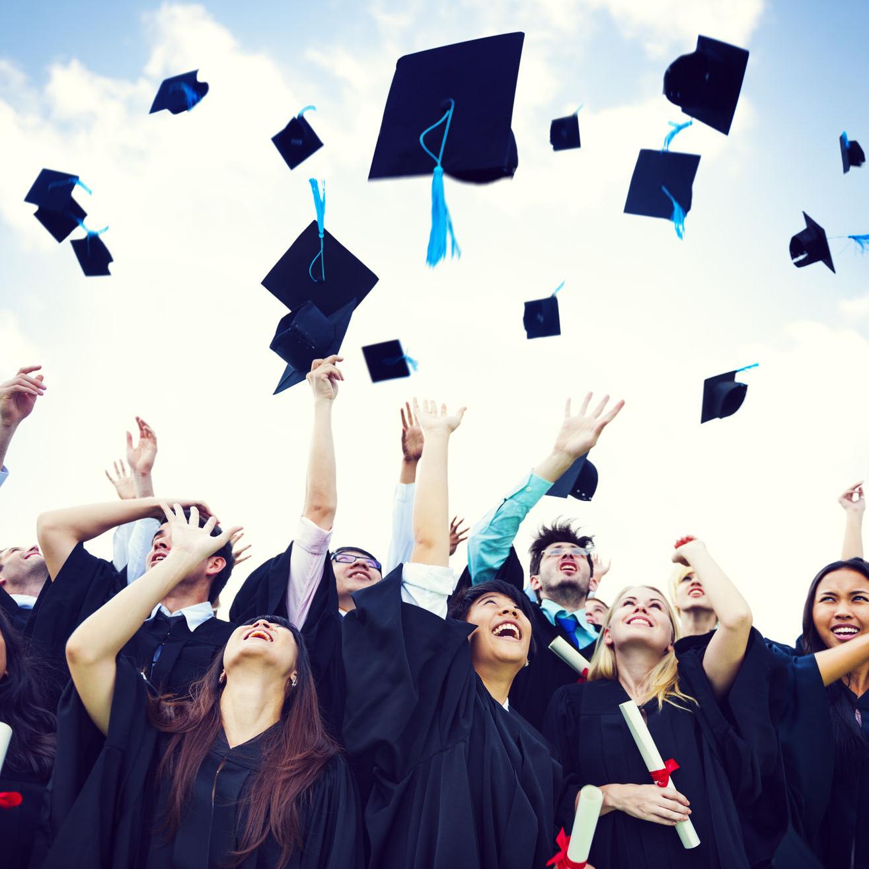 31315940 - graduation caps thrown in the air